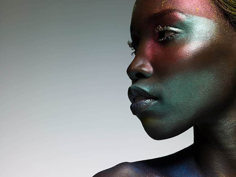 Girl showcasing moonshine ultra effect pigments from Croda